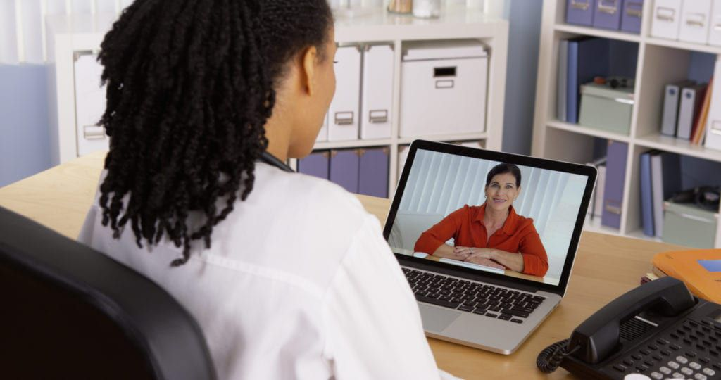 female psychiatrist having a teleconference with a patient
